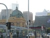 Flinders St Station and some of the new grey trams